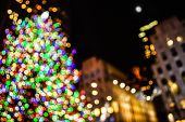 picture of rockefeller  - An abstract blur of the Rockefeller Center Christmas Tree and surrounding buildings - JPG