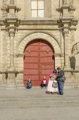 LA PAZ, BOLIVIA, MAY 8, 2014: Local people gather in front of Basilica of San Francisco