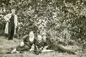 GERMANY, SEPTEMBER 28, 1940: Vintage photo of family with little boy outdoor