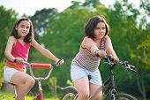 Two Hispanic Children Riding On Bikes