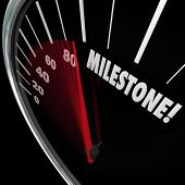 Milestone word on a speedometer with needle reaching the turning point, special moment or time of important achievement or goal