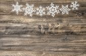 Christmas Ornament White Snowflakes On Wooden Background