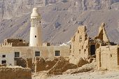 Ruin of an old mud brick fortress and a village mosque near the city of Seiyun, Yemen.
