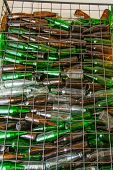 Emty Bottle In Basket Steel