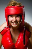 Funny boxer against dark background