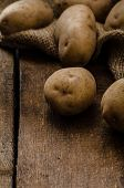 picture of hard-on  - Raw potatoes on wood hard board prepare for gnocchi - JPG