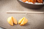 image of fortune-teller  - two chinese fortune cookies on brown place mat - JPG