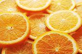 picture of valencia-orange  - background made of few sliced juicy oranges - JPG