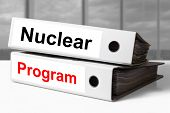 stock photo of centrifuge  - stack of white office binders nuclear program - JPG