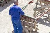 foto of air paint gun  - Photo of the Paint worker painting metal designs - JPG