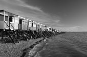 foto of beach hut  - Black and white image of the beach huts along the sea front at Thorpe Bay near Southend - JPG