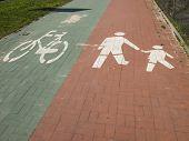 foto of bike path  - way of a separate bicycle path and sidewalk bike and walking path marks - JPG