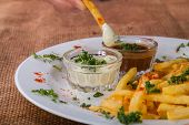 picture of high calorie foods  - French fries on a plate with different spices - JPG