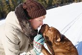 stock photo of shar pei  - Woman playing with her shar pei on a winter sunny day - JPG