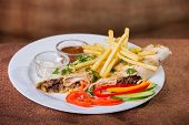 image of shawarma  - Dish in white plate with Shawarma  - JPG