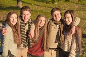 stock photo of bff  - Cute group of European teenagers embracing each other - JPG