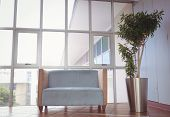 foto of reception-area  - Reception area with couch and large window - JPG