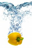 image of yellow-pepper  - Fresh yellow pepper dropped into water with splash isolated on white - JPG