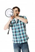 image of yell  - Young man yelling into megaphone - JPG