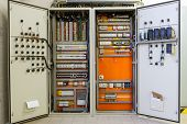 stock photo of breaker  - Electricity distribution box with wires circuit breakers and fuse box - JPG
