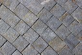 foto of paving stone  - Backgrounds of pavement made of grey granite paving stones - JPG