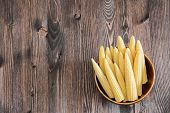 picture of maize  - Maize ears on old wooden background with copy space - JPG