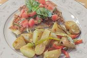 image of crust  - Healthy yet filling parmesan crusted chicken breast topped with diced tomato and fresh basil and a side of scrumptious fingerling potaoes - JPG