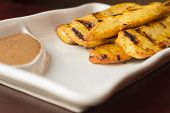 image of sate  - Thai chicken satay skewers with spicy peanut sauce for dipping  - JPG