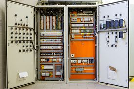 foto of breaker  - Electricity distribution box with wires circuit breakers and fuse box - JPG