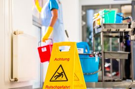 stock photo of warning-signs  - Warning sign on floor in cleaning operation - JPG