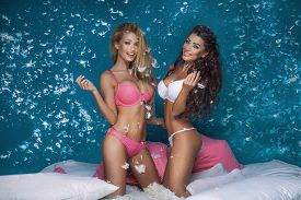 pic of pillow-fight  - Beautiful sexy two girls having fun in bedroom pillow fight - JPG