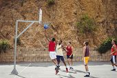 Basketball players playing basketball in the court outdoors poster