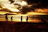 Kids plying on the beach