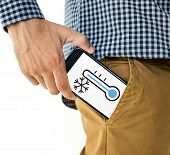 Hand holding digital device network graphic overlay from trouser pocket poster