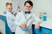 Schoolchildren With Science Lab Equipment In Chemical Lab, Scientists Kids Team Concept poster