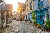 Charming Street Scene In An Old Town In Europe At Sunset poster