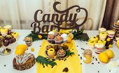 Holiday Candy Bar In Yellow And Brown Color. Wedding Candy Bar Served With Cupcakes, Cake Pops, Dess poster