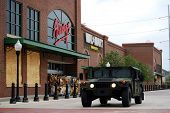 NEW ORLEANS - SEPT 1: National Guard troops in a Humvee guard a Wal-Mart which had been closed and f