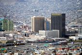 EL PASO, TEXAS - FEB 25: Downtown El Paso, Texas, with a busy border crossing and houses on the moun