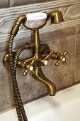 image of mixing faucet  - The beautiful bronze faucet in a bathroom - JPG