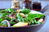 Apple Salad With Basil, Raisins And Blue Onions. Salad With Apple And Peanuts. Healthy Vegan Salad.  poster