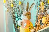 Easter Composition With Toy Rabbit And Eggs Hanging On Pussy-willow Bouquet On The Blue Background poster
