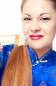 girl  eating sushi