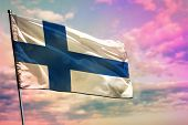 Fluttering Finland Flag On Colorful Cloudy Sky Background. Finland Prospering Concept. poster