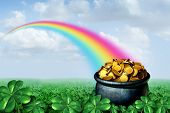 Pot Of Gold At The End Of A Rainbow Saint Patricks Day Concept With A Green Clover Field On A Golden poster