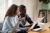 Concerned Black Couple Read Bills Considering Paperwork At Home poster
