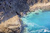 Idyllic Coastal Bays And Sea Caves Exploring poster