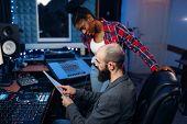 Bearded sound engineer in audio recording studio poster