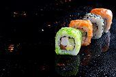 Colorful Sushi Sets With Lots Of Sushi, Roll . Stylish Sushi Sets On A Black Background With Water D poster