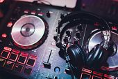 Music Console And Headphones For Dj. Dj Console Cd Mp4 Deejay Mixing Desk Music Party In Nightclub.  poster
